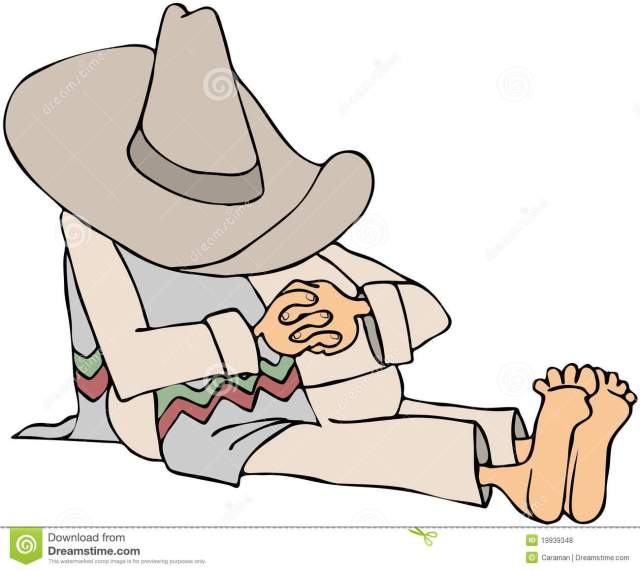 man-wearing-sombrero-taking-siesta-19939348